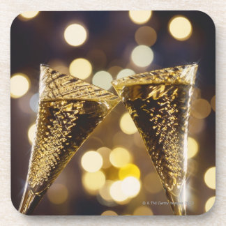 Toasted champagne flute, close-up coaster