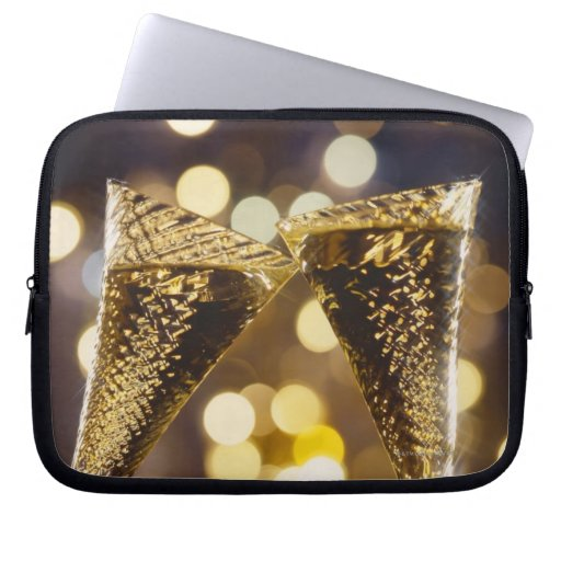 Toasted champagne flute, close-up laptop computer sleeve