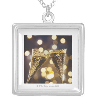 Toasted champagne flute, close-up personalized necklace