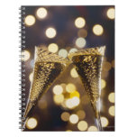 Toasted champagne flute, close-up notebooks