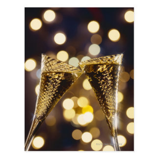 Toasted champagne flute, close-up postcard