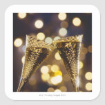Toasted champagne flute, close-up square sticker