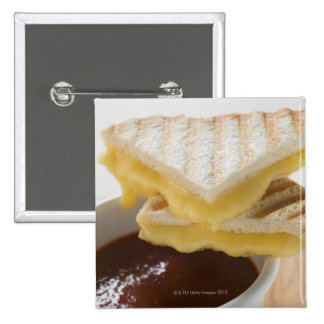 Toasted cheese sandwiches & a cup of tomato soup button