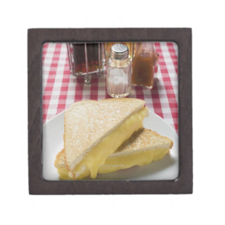Toasted cheese sandwiches on plate, vinegar, keepsake box