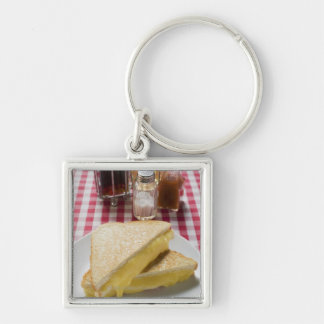 Toasted cheese sandwiches on plate, vinegar, keychain