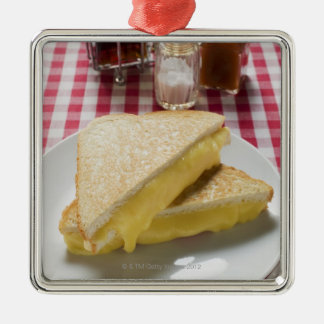 Toasted cheese sandwiches on plate, vinegar, metal ornament