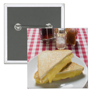 Toasted cheese sandwiches on plate, vinegar, pinback button