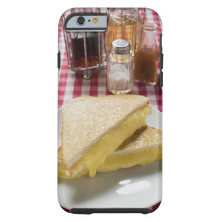 Toasted cheese sandwiches on plate, vinegar, tough iPhone 6 case