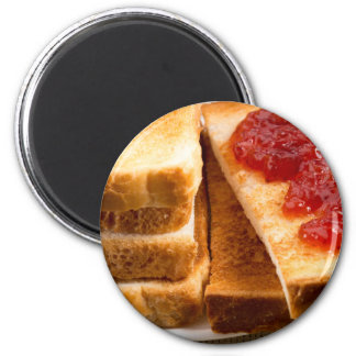 Toasted slices of bread with strawberry jam magnet