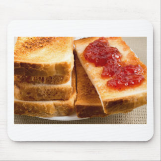 Toasted slices of bread with strawberry jam mouse pad