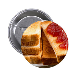 Toasted slices of bread with strawberry jam pinback button