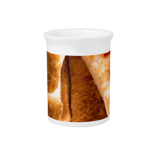 Toasted slices of bread with strawberry jam pitcher