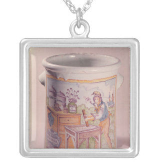 Tobacco pot depicting a tobacconist silver plated necklace