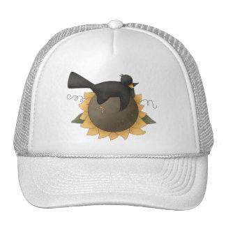 Todas las bendiciones del dem · Cuervo y girasol Gorro