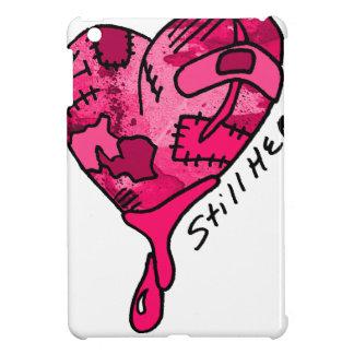 Todavía aquí corazón rosado del remiendo