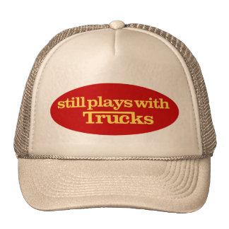 Todavía juegos con el gorra de los camiones
