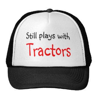 Todavía juegos con los tractores gorros