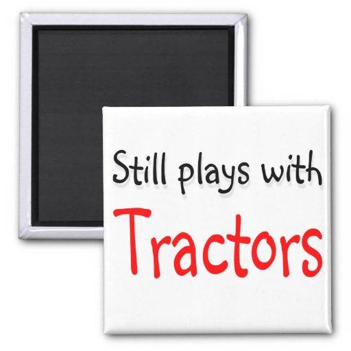 Todavía juegos con los tractores imanes de nevera