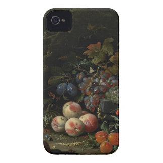 Todavía vida con la fruta, el follaje y los iPhone 4 carcasa