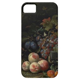 Todavía vida con la fruta, el follaje y los iPhone 5 funda
