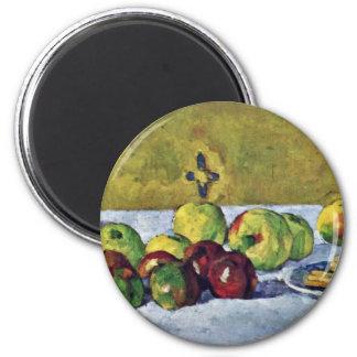 Todavía vida con las manzanas y las galletas imanes para frigoríficos