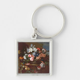 Todavía vida de flores en una cesta llaveros personalizados