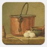 Todavía vida de utensilios de cocinar, caldera pegatina cuadrada