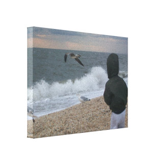 toddler intrigued by seagulls at Sunset Beach, NJ Canvas Print