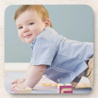 Toddler playing with blocks beverage coaster