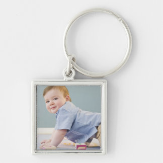 Toddler playing with blocks keychain