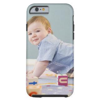 Toddler playing with blocks tough iPhone 6 case