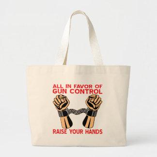 Todos a favor de aumento del control de armas sus  bolsas de mano
