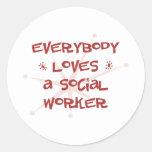 Todos ama a un asistente social pegatinas redondas