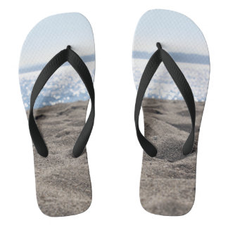 Toes in the sand flip flops