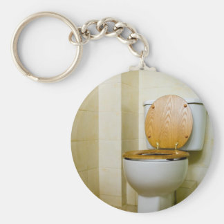 Toilet bowl in hotel bathroom keychains