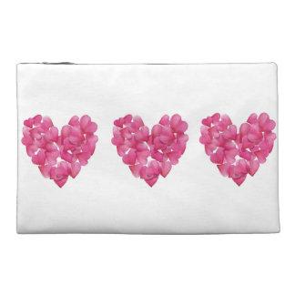 Toiletry bag pink petals heart design.