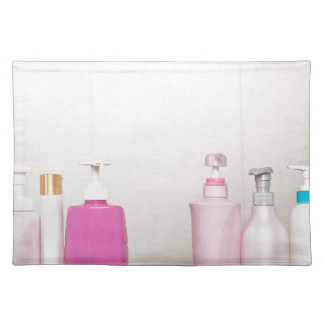 Toiletry bottles in bathroom cloth place mat