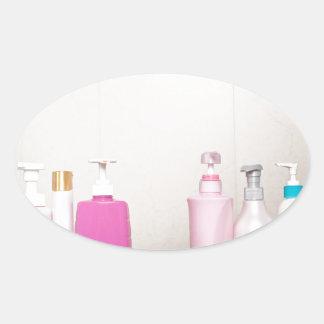 Toiletry bottles in bathroom oval sticker