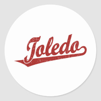 Toledo script logo in red distressed classic round sticker