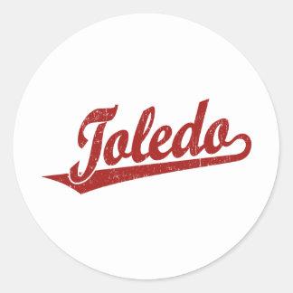 Toledo script logo in red distressed round stickers
