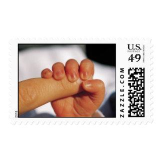 Tomar el dedo del papá sello