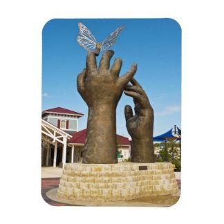 Tomar la escultura del vuelo imán