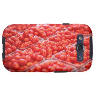 Tomates de cereza en una parada del mercado galaxy SIII coberturas