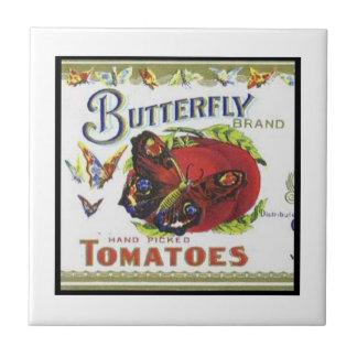 Tomates de la marca de la mariposa teja cerámica