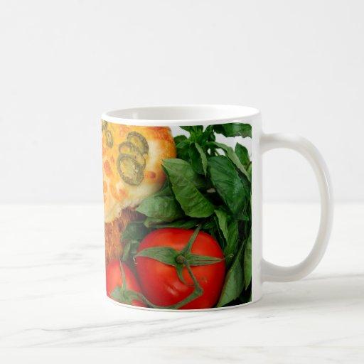 Tomates de las hierbas del pan taza de café