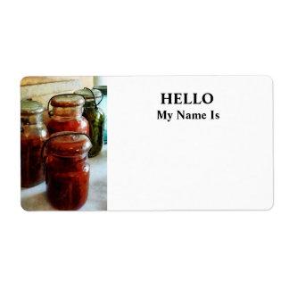 Tomates e hilo en tarros de enlatado etiquetas de envío