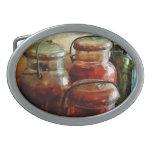 Tomates e hilo en tarros de enlatado hebillas cinturón
