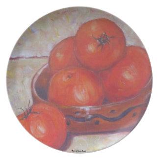 Tomates en una placa del plato