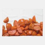 Tomates frescos del corte toallas de cocina