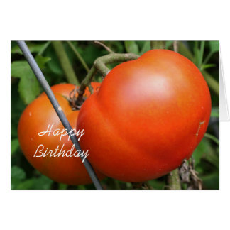 Tomates rojos en tarjeta de cumpleaños de la